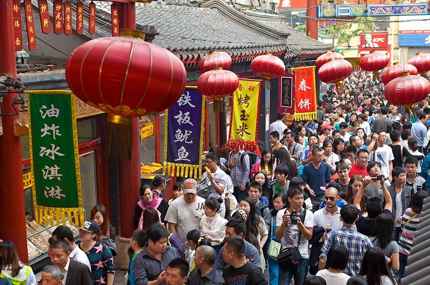 Beijing, China - October 4, 2013: People crowd famous Wangfujing snack street during National Day holiday