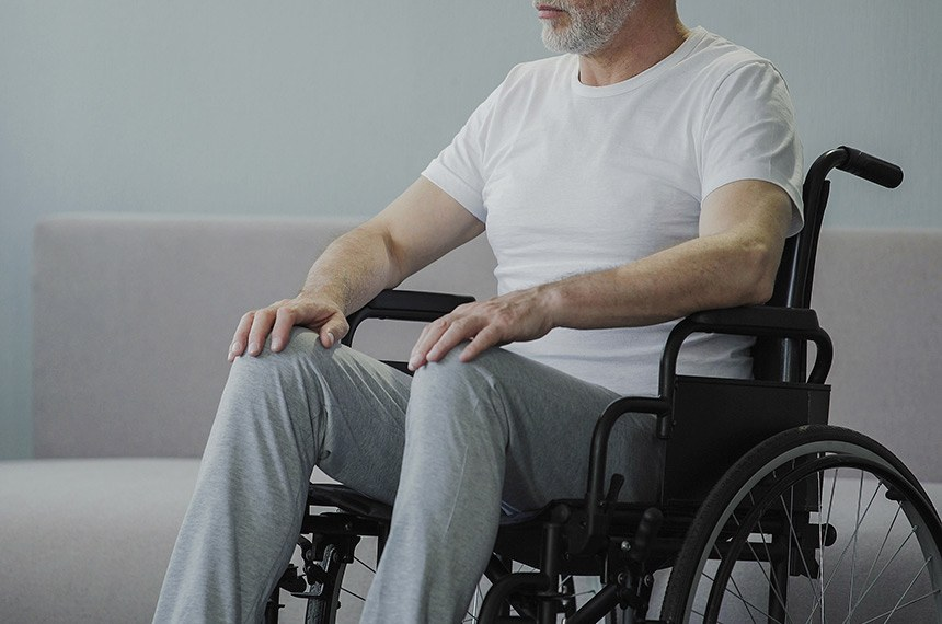 Thoughtful retired male sitting in wheelchair  -----------  Homem idoso em cadeira de rodas