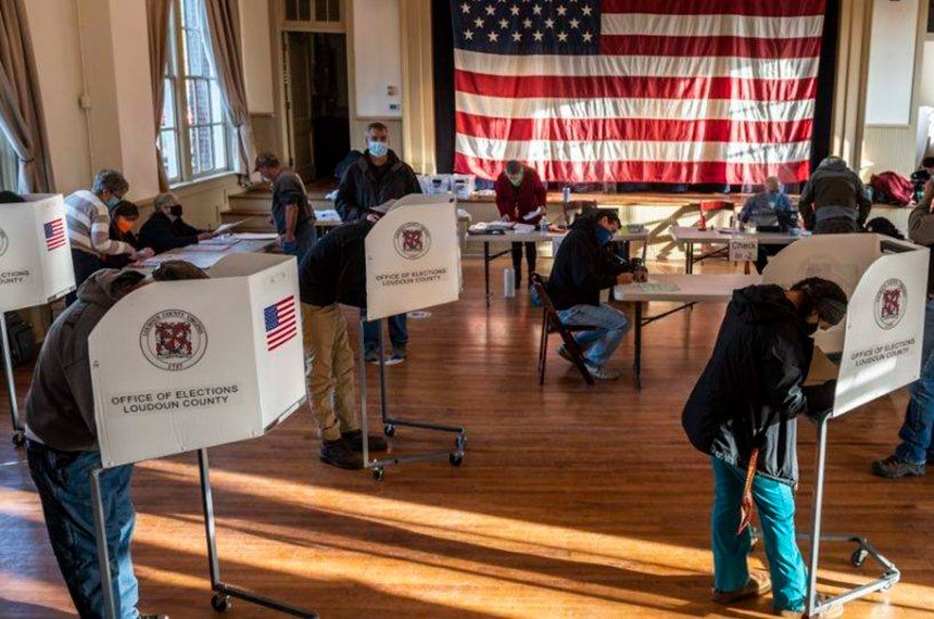 """Voters cast their ballots at the old Stone School, used as a polling station, on election day in Hillsboro, Virginia on November 3, 2020. - Polling stations opened in New York, New Jersey and Virginia early Tuesday, marking the start of US Election Day as President Donald Trump seeks to beat forecasts and defeat challenger Joe Biden. The vote is widely seen as a referendum on Trump and his uniquely brash, bruising presidency that Biden urged Americans to end to restore """"our democracy."""" (Photo by ANDREW CABALLERO-REYNOLDS / AFP)"""