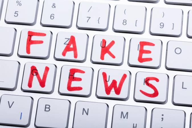 Words Fake News Written On A Keyboard
