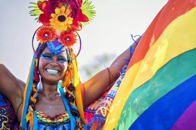 Rio de Janeiro, Brazil - February 9, 2016: Beautiful Brazilian woman of African descent wearing colourful costume and smiling at Carnaval 2016 parade in Rio de Janeiro, Brazil.